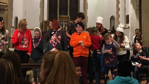 Children and staff perform at the Swings & Smiles Carol Concert