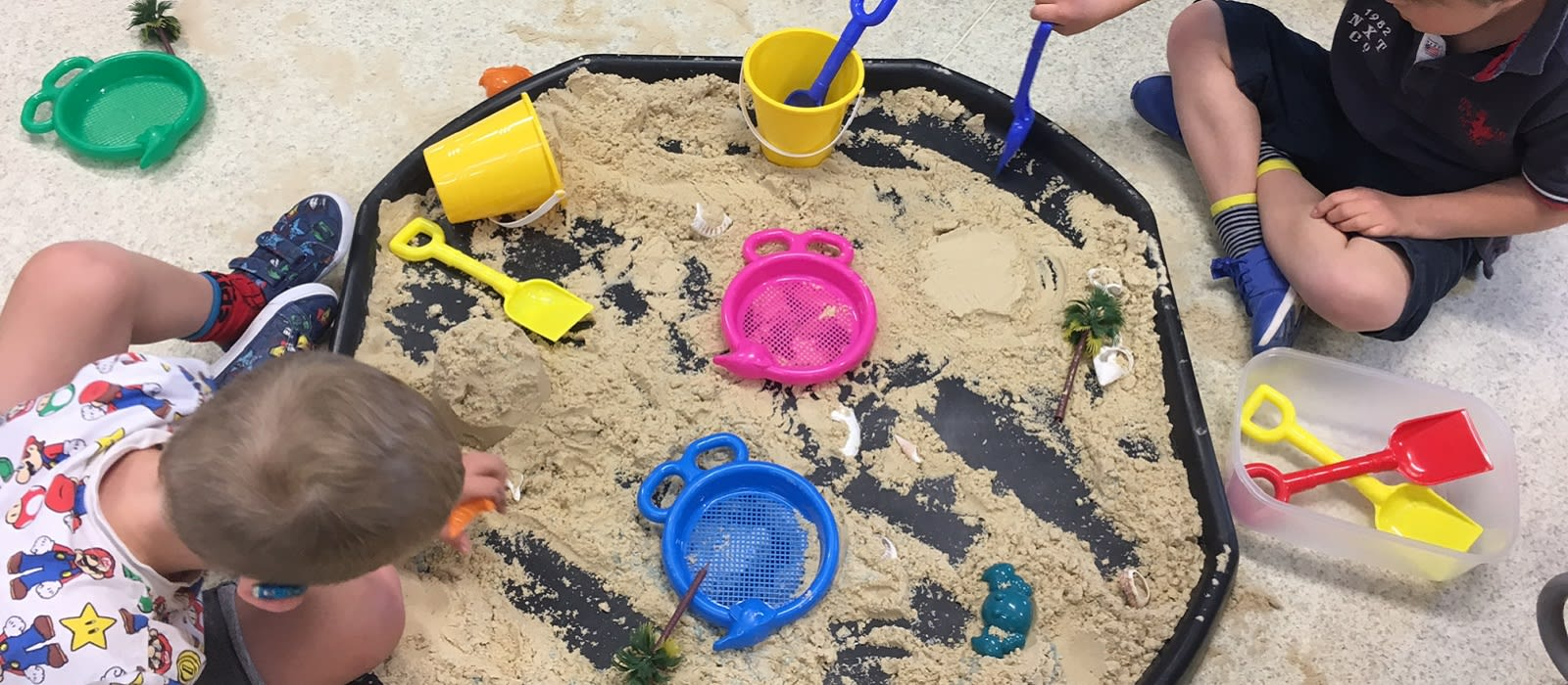 Children playing at a sensory beach-themed outreach session
